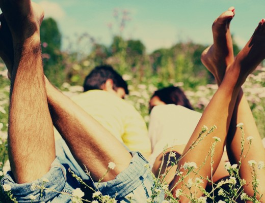 lovely-couple-lying-on-a-grass